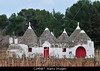 P11.14 Trullo from Southern Italy (Cone-shaped house, white, with thatched roof)<br /> <br /> Choice 11 of 13<br /> <br /> C2MNB7 Locorotondo. Puglia. Italy. Trullo in the countryside between Locorotondo and Alberobello.