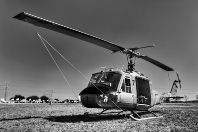 The Huey Air support has played a major role in all recent wars, especially in Vietnam. The UH-1E Huey was the first turbine-powered helicopter to enter production for the United States military, and more than 16,000 have been produced worldwide. The first combat operation of the UH-1 was in the U.S. Army during the Vietnam War, with approximately 7,000 UH-1 aircraft used for that war. I thought it proper to process it in black and white, due to the era when it served our country saw little color film.