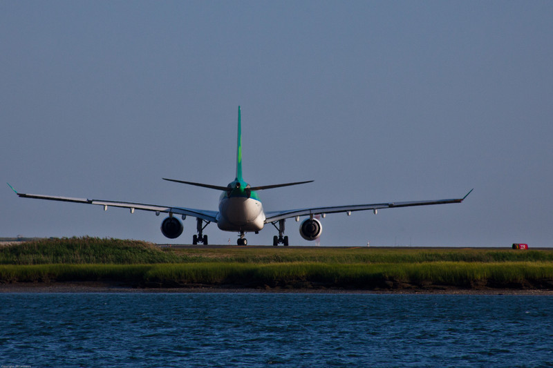 Aer Lingus A330 turning onto Boston Logan Runway 22R and immediately begins its early evening departure roll.