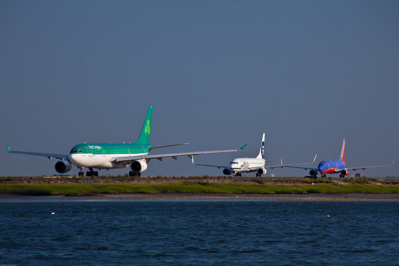 Early evening traffic lining up to depart Boston Logan on Runway 22R.