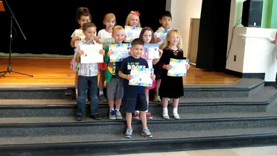 Posing for pictures at the end of the Kindergarten Awards