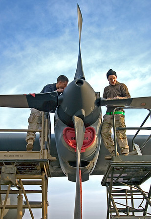3rd Place, MOAA 2007:  Air Force maintainers repairing a C-130 prop.