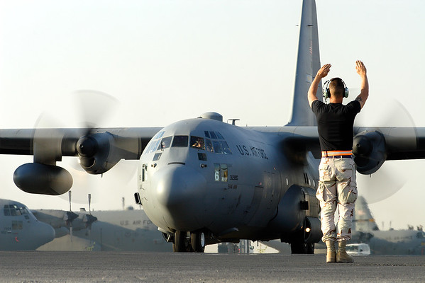 3rd Place, MOAA 2006--Crew chief marshaling out C-130; Southwest Asia.