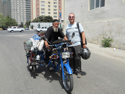 Having dropped our bikes off at the port, we bump into this badass Uzbek.
