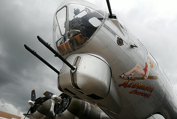 "The World War II B-17 bomber ""Aluminum Overcast"" sits under cloudy skies at the Mankato Regional Airport Tuesday. Photo by Pat Christman"