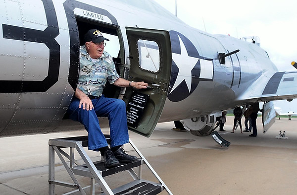 """George """"Bud"""" Shurson makes his way out of the tail of the B-17 during a tour Tuesday. Photo by Pat Christman"""