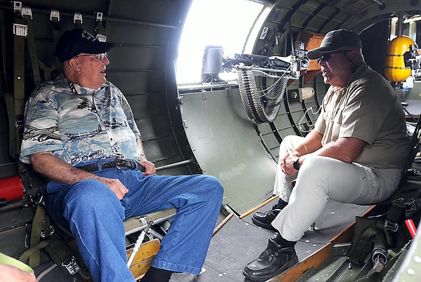 "World War II veteran George ""Bud"" Shurson talks with B-17 Flying Fortress ""Aluminum Overcast"" pilot Shawn Knickerbocker while sitting aboard the plane during its visit to Mankato Tuesday at the Mankato Regional Airport. Shurson flew 50 missions aboard a B-17 as a gunner. Photo by Pat Christman"