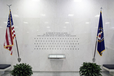 "The Stars on the Wall  The CIA Memorial Wall is one of the first things visitors see when entering the Original Headquarters Building lobby. The wall – located on the lobby's north wall – stands as a silent memorial to those CIA employees ""who gave their lives in the service of their country."" Currently, there are 102 stars carved into the marble of the CIA Memorial Wall.  The""Book of Honor"" lists the names of 62 employees who died while serving their country. The names of the remaining 40 employees must remain secret, even in death; each of these officers is remembered in the book by a star."