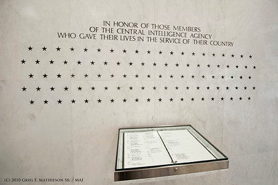 The CIA  Memorial Wall inside the entrance of the Central Intelligence Agency Headquarters which currently has 102  stars engraved for each member of the agency that gave of his/her life in the line of duty.  Names of those are listed in the book below, with a 37 not being listed and will remain Secret for the nature of the work they were doing.  Photo: Greg E. Mathieson Sr. / MAI