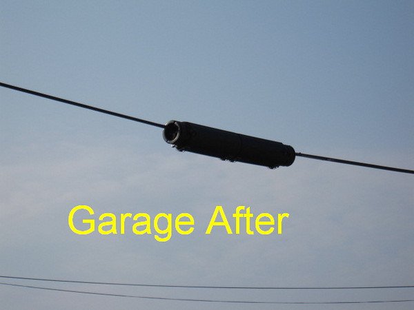 Garage -- Contractor replaced splice box with correct aerial container.