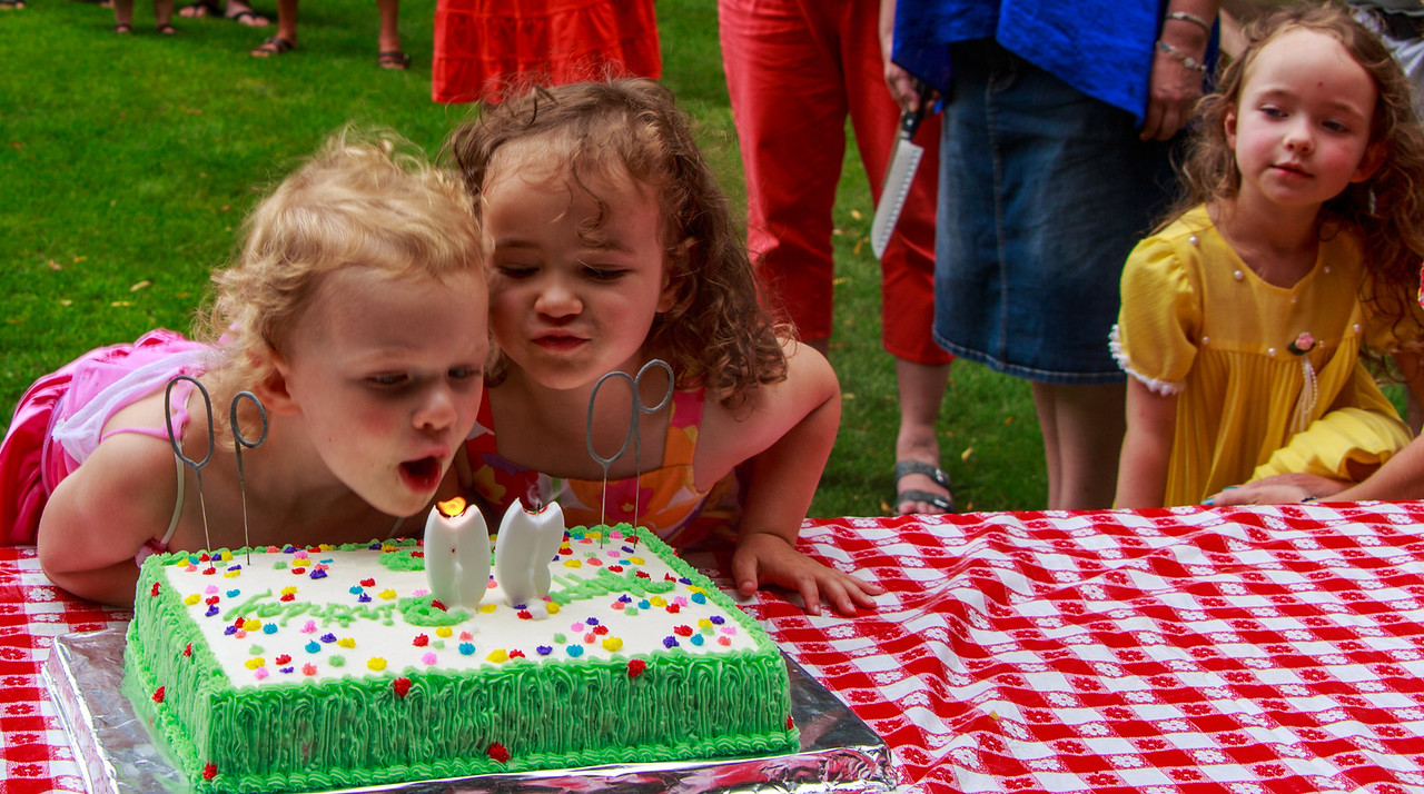 A couple of really cute volunteers to blow out the candles.