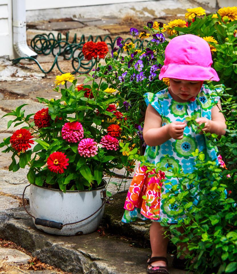 Danika investigating Mimi's flowers.