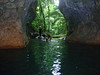 swimi into the rainforest cave entrance 15 feet of chilly water..don helmets and head lamps and start wading...