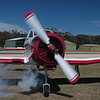 The Yak 18T's Vedeneyev M14P bursts into life with traditional radial engine smoke.