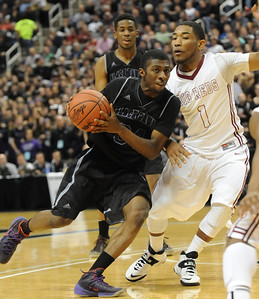 Bloomfield Hills' Armand Cartwright drives to the basket against Muskegon defender Deshaun Thrower during their Class A state championship game Saturday at the Breslin Center in East Lansing. (Photo gallery by Ken Swart for The Oakland Press)