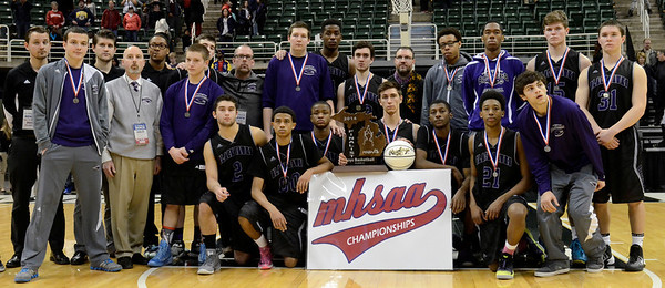 The Bloomfield Hills basketball team poses with its state runner-up trophy Saturday. (For The Oakland Press/KEN SWART)