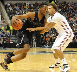 Bloomfield Hills' Yante Maten (11) drives around Muskegon's Jamarie Collins (12) during the first quarter of the MHSAA Class A State Championship game played on Saturday March 22, 2014 at the Breslin Center in East Lansing.  Bloomfield Hills lost the final to Muskegon 91-67.  (Special to the Oakland Press/KEN SWART)