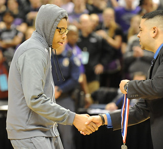 Bloomfield Hills' Oronde Bynum receives his finalist medal after the Class A state championship game against Muskegon Saturday at the Breslin Center in East Lansing. (Photo gallery by Ken Swart for The Oakland Press)