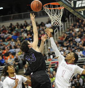 Bloomfield Hills' Eric Weiss (33) lays the ball up between Muskegon's Deshaun Thrower (1), and Joeviair Kennedy (L) during the second quarter of the MHSAA Class A State Championship game played on Saturday March 22, 2014 at the Breslin Center in East Lansing.  Bloomfield Hills lost the final to Muskegon 91-67.  (Special to the Oakland Press/KEN SWART)