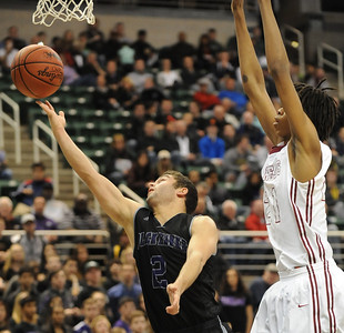 Dylan Deitch (2) of Bloomfield Hills beats Muskegon's Deyonta Davis (21) to the basket during the third quarter of the MHSAA Class A State Championship game played on Saturday March 22, 2014 at the Breslin Center in East Lansing.  Bloomfield Hills lost the final to Muskegon 91-67.  (Special to the Oakland Press/KEN SWART)