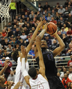Bloomfield Hills' Yante Maten puts up a shot against a pair of Muskegon defenders during their Class A state championship game Saturday at the Breslin Center in East Lansing. (Photo gallery by Ken Swart for The Oakland Press)