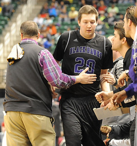 Bloomfield Hills' Logan McDonald gets a warm reception from head coach Duane Graves during the Class A state championship game against Muskegon Saturday at the Breslin Center in East Lansing. (Photo gallery by Ken Swart for The Oakland Press)