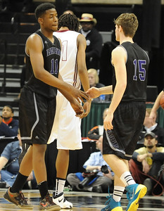 Bloomfield Hills' Yante Maten and Jacob Hecker slap hands during their Class A state championship game against Muskegon Saturday at the Breslin Center in East Lansing. (Photo gallery by Ken Swart for The Oakland Press)