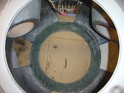 Bottom of torso needed filling up to level of bottom edge of vent opening. This aids in installation of vent rails and will add a lot of strength to the torso. You can see the original fiber in gray and the Tiger Hair Fiberglass that was applied in green.