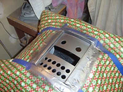 """Painting the chest with Duplicolor gunmetal. Using up the left over """"ugly"""" Xmas wrapping paper!"""