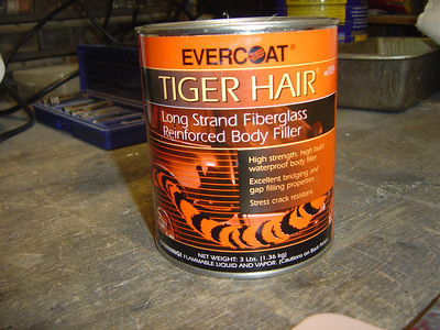 Evercoat Tiger Hair used for filling in and reinforcing areas like inside the torso base and inside the donut on the outer edge. Very long fiberglass hairs so should be very strong!