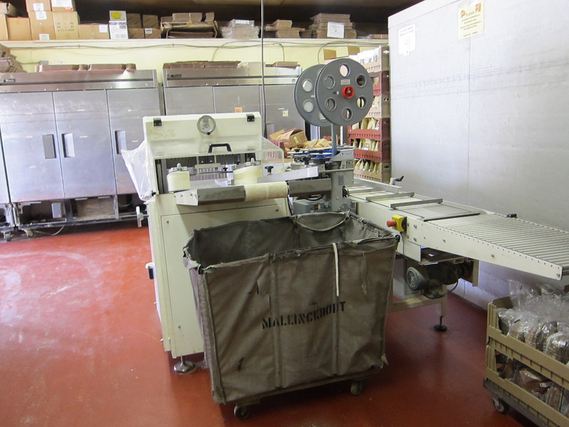 Hoba Holly Slicer with conveyor table and Kwik Lok
