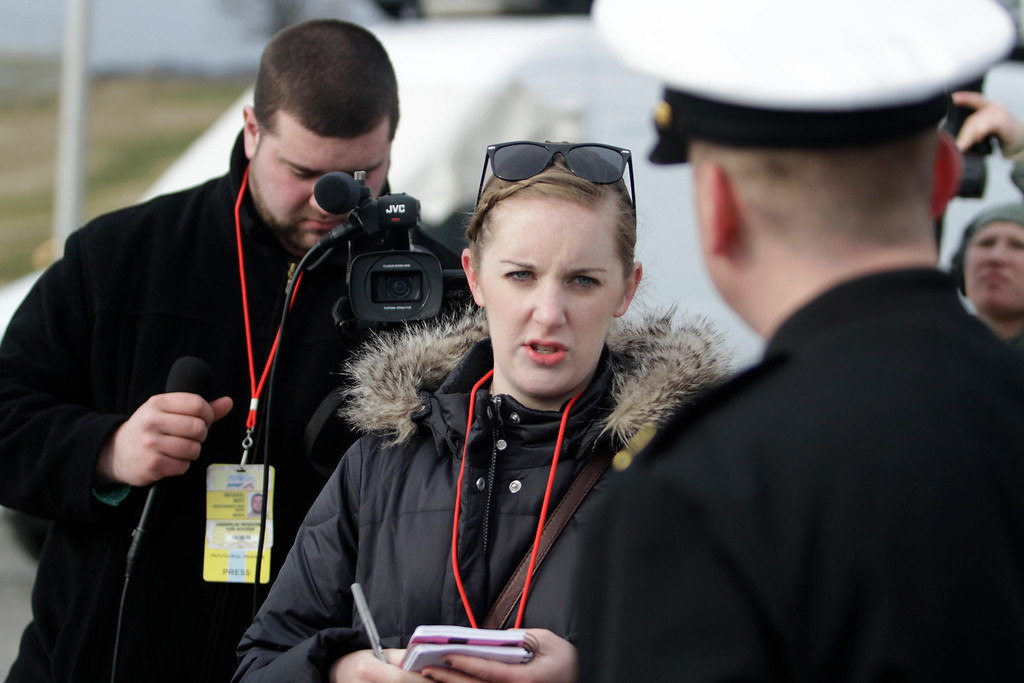 Boston University graduate student Jenni Whalen, center, and senior Mike Neff, interview a member of the United States Navy Band prior to the Inauguration Day Parade on January 21 in Washington D.C. (MICHAEL CUMMO/ Boston University News Service)
