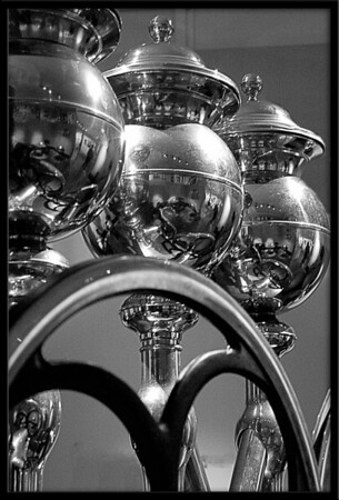 Large coffee grinder in the Malmo museum as part of a history of coffee in Sweden display.<br /> <br /> The top parts are the hoppers to hold the coffee beans before grinding.<br /> <br /> The room was quite dark and no flash photography was allowed, but I loved the shapes and thought B&W would look pretty cool so snapped away hand held as steady as I could. Converted to B&W in Photoshop.