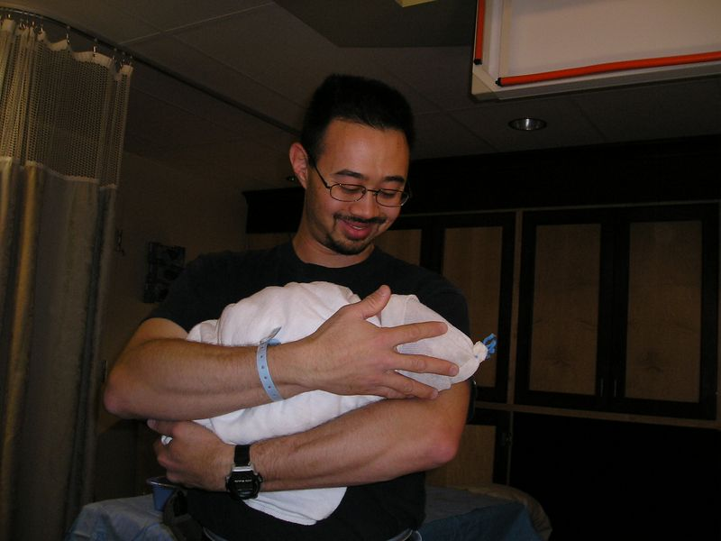 Sean holds baby Timothy at the hospital.