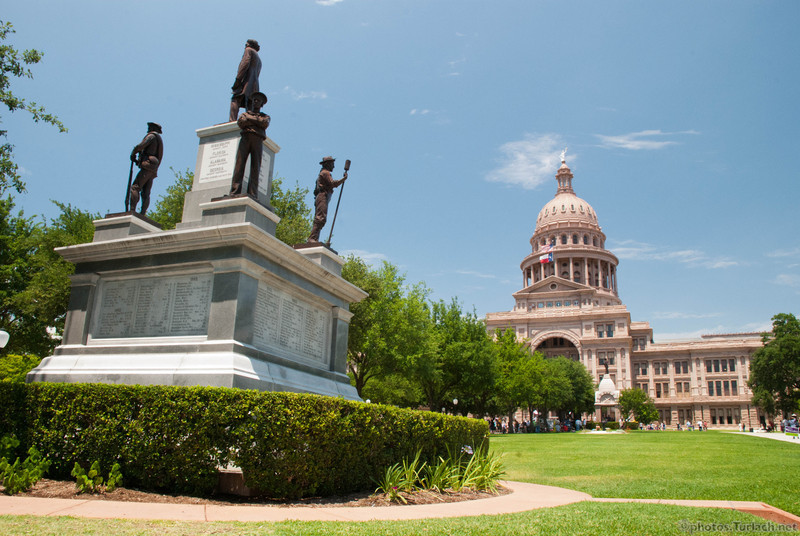 A confederacy memorial sits in front of the Texas State House.