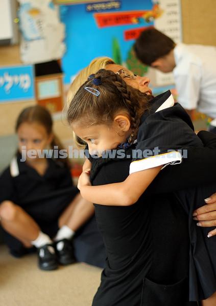 1st day of school 2010. Bialik College, Grade 1. First day wearing school uniform. Grade 1 student Jade Stern hugs Carolyn Jagoda. Photo: Peter Haskin