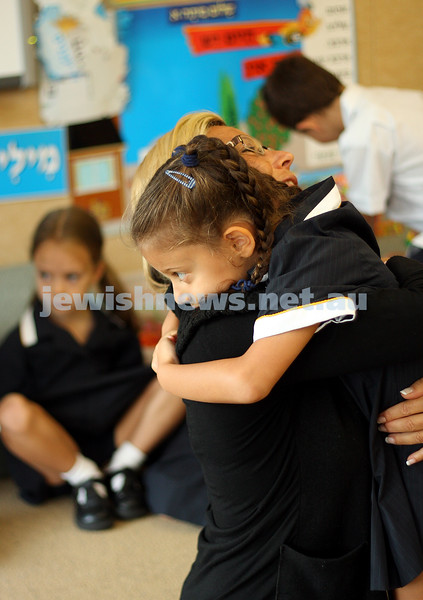 1st day of school 2010. Bialik College, Grade 1. First day wearing school uniform. Grade 1 student Jade Stern hugs Carolyn Jagoda. Photo: Peter Haskin