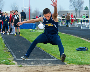 Skip Traynor - Special to the Sun Ithaca long jumper Blake Reyes stretches for distance during a double dual meet between Breckenridge, Ithaca and St. Louis at Ithaca High School Wednesday, April 30, 2014.