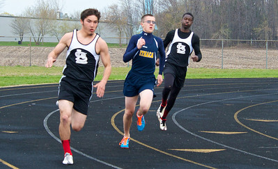 Skip Traynor - Special to the Sun St. Louis sprinters Cody Kostal and Eddie Jackson battle Ithaca's Ethan Schauer in the first turn of the 400-meter during a double dual meet between Breckenridge, Ithaca and St. Louis at Ithaca High School Wednesday, April 30, 2014.