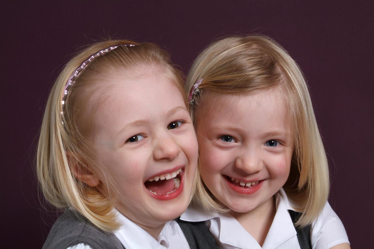 pretty blonde girls isolated on dark background