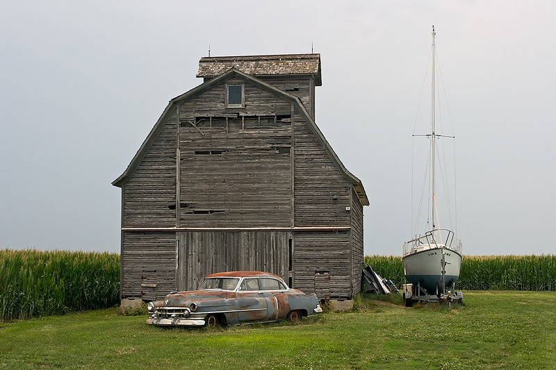 Cadillac, barn and boat along Lincoln Highway, Illinois<br /> ©2012 Peter Aldrich