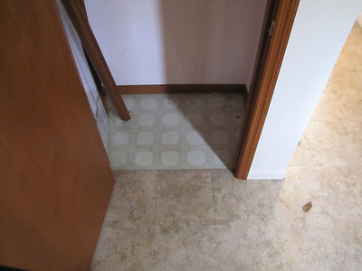 Fake tile floor doesn't extend into closet