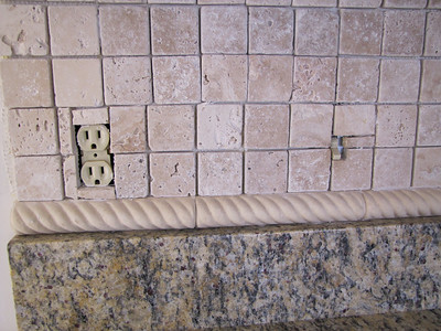 Tiled over the outlets and didn't line up grout lines.