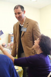 Frank Janik shares a light moment with Dalia Alterovitz of Avon as she holds up a campaign advertisement from her table. photo by Ray Riedel