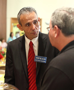 Ted Kalo discusses an issue with John Carney. photo by Ray Riedel