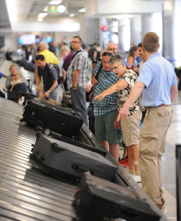 . At LAX, passengers collect their baggage at the carousels at United Airlines and American Airlines. Photo by Brad Graverson 7-25-13