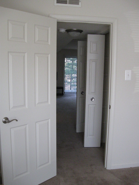 looking from bedroom through hall to living room