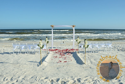 White Fabric and Chair Sashes with Tiki Torches in Aisle