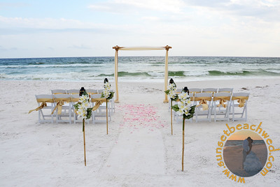 Champagne and Ivory Fabric with Tiki Torches in Aisle