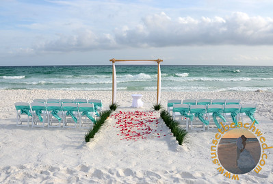 White Fabric on Arbor with Turquoise Chair Sashes, Dark and Light Pink Rose Petals.